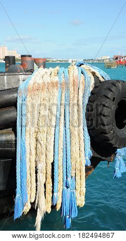 Colorful ropes on a fishing boat displayed outside.
