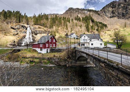 Steinsdalfossen waterfall with souvenir shop in Steine Norway