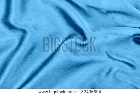 Blue wavy silk fabric close up image