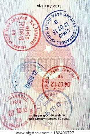Visa stamps in Turkish passport close up image