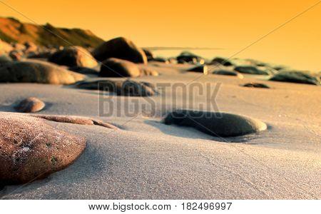 Beach sand and rocks close up image