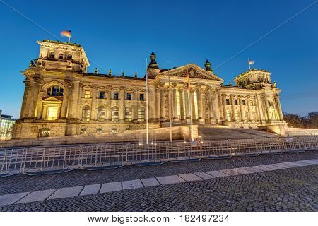 The famous german Reichstag in Berlin illuminated at dawn