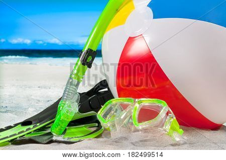 Summer vacation on the seaside beach. Mask with snorkel and flippers on the beach