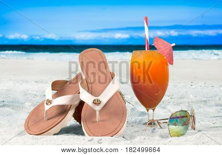 Summer vacation on the seaside beach. Fresh cocktail on beach background
