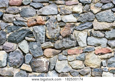Old stacked stone wall of fortress. Background texture