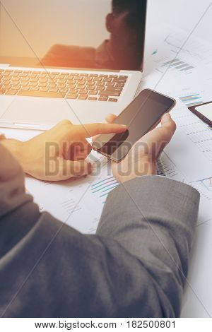 Young Businessman Working At Office, Writes Marketing Plans And On The Notepad Strategy Diagram As C