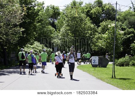 Laval, Quebec - June 14, 2015 -- Wide view of a large group of walkers participating in the