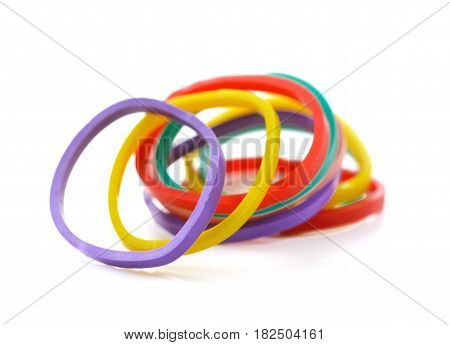 Top view of colorful rubber bands isolated on white Elastic bands on a white
