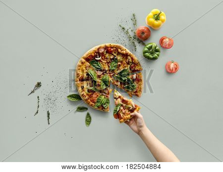 Hand taking a slice of italian cuisine pizza