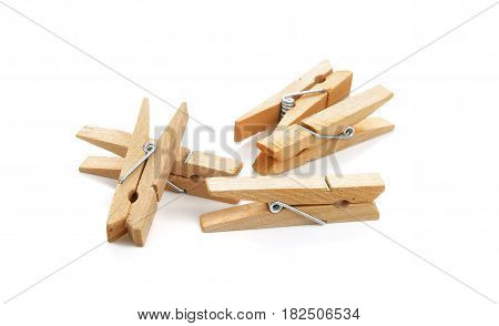 Wooden clothespin composition isolated over the white background