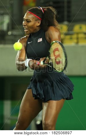 RIO DE JANEIRO, BRAZIL - AUGUST 8, 2016: Olympic champions Serena Williams of United States in action during her singles round two match of the Rio 2016 Olympic Games at the Olympic Tennis Centre