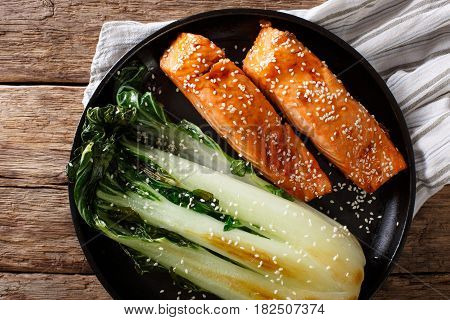 Salmon In Honey-soy Glaze And Fried Bok Choy Close-up. Horizontal Top View