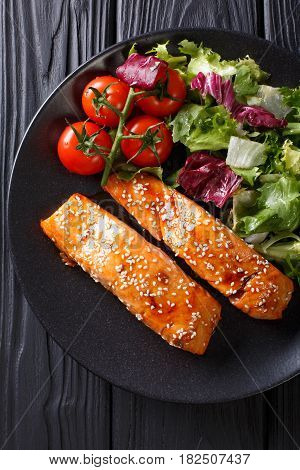 Delicious Glazed Salmon Fillet With Sesame And A Salad Of Fresh Vegetables Close-up. Vertical Top Vi
