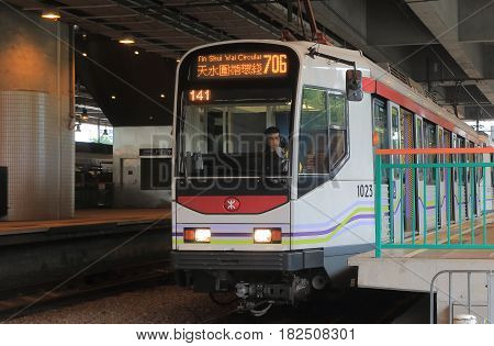 HONG KONG - NOVEMBER 11, 2016: Light Rail Transit LRT train. LTR is a light rail system in Hong Kong, serving the New Territories West, within Tuen Mun District and Yuen Long District.