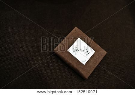 Brown Textile Flash Box With Flash Drive Inside.