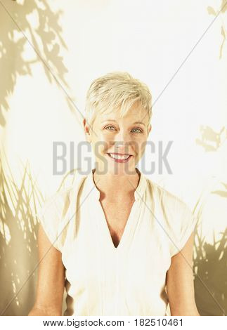 Middle-aged woman smiling in sunlight