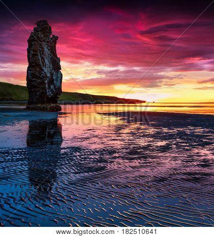 Huge basalt stack Hvitserkur on the eastern shore of the Vatnsnes peninsula. Colorful summer sunrise in northwest Iceland Europe. Artistic style post processed photo.