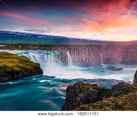 Summer morning scene on the Godafoss Waterfall. Colorful sunset on the on Skjalfandafljot river Iceland Europe. Artistic style post processed photo.