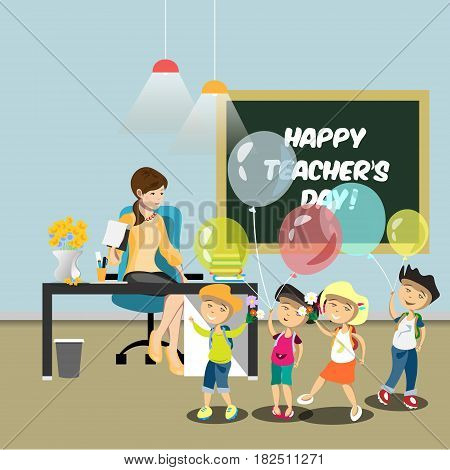 Children congratulate the teacher in the classroom. Children give flowers to the teacher