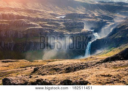 Typical Icelandic landscape in the mountains. Colorful summer morning with waterfall in the Iceland Europe. Artistic style post processed photo.