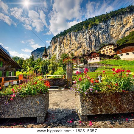 Colorful summer view of Lauterbrunnen village. Beautiful outdoor scene in Swiss Alps Bernese Oberland in the canton of Bern Switzerland Europe. Artistic style post processed photo.