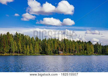 Wooden Sauna Log Cabin At The Lake In Summer In Finland