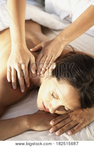 Hispanic woman receiving massage