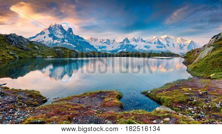 Colorful summer morning on the Lac Blanc lake with Mont Blanc (Monte Bianco) on background Chamonix location. Beautiful outdoor scene in Vallon de Berard Nature Preserve Graian Alps France Europe.