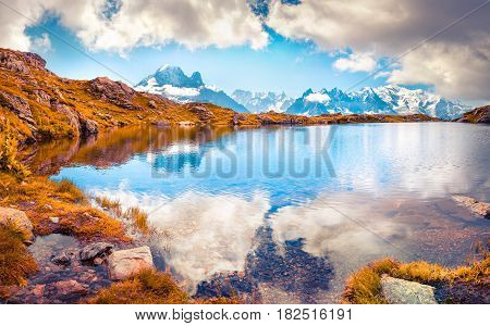 Colorful autumn morning on the Lac Blanc lake with Mont Blanc (Monte Bianco) on background Chamonix location. Beautiful outdoor scene in Vallon de Berard Nature Preserve Graian Alps France Europe