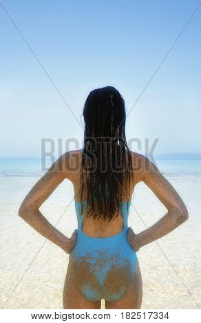 Rear view of Pacific Islander woman at beach