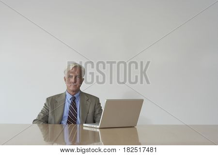Businessman at table with laptop