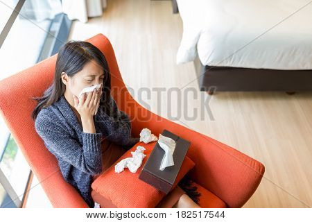 Top view of woman feeling sick at home