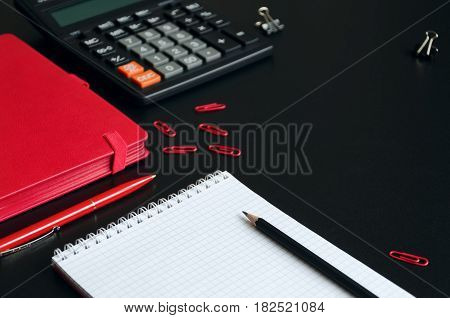 Office desk table with notebook calculator pen and pencil. Copy space. Focus is on the pencil