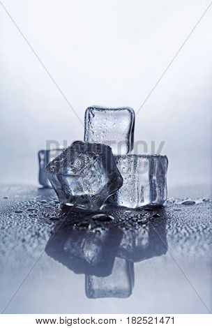 Group Of Blue Wet Ice Cube With Reflection