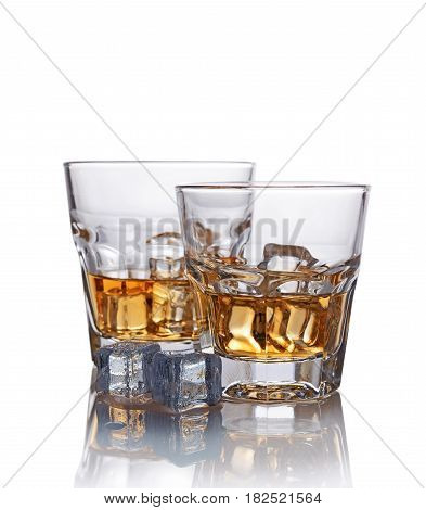 Two Glasses Of Scotch Whiskey With Ice Cube