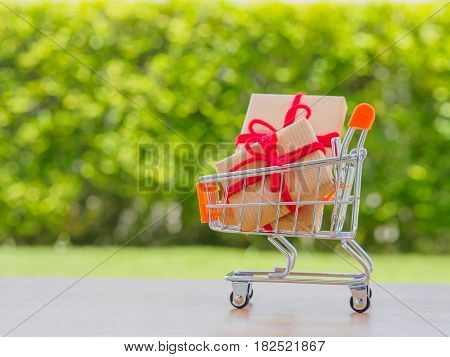 Celebration concept. Many New Year and Christmas presents or gifts represented in shopping cart