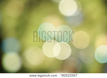green background with lights in the distance, bokeh