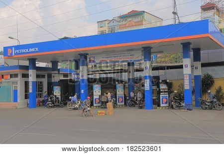HANOI VIETNAM - NOVEMBER 22, 2016: Unidentified people buy gasoline at Petrolimex petrol gas station.