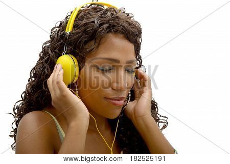 African woman listening to music with yellow headphones