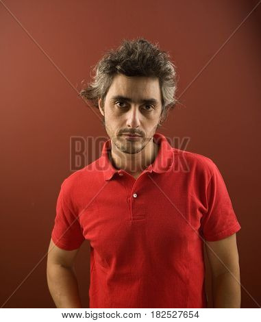 Hispanic man with messy hair