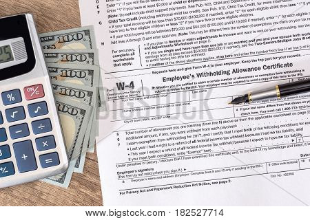 W4 Tax Form With Money And Pen.