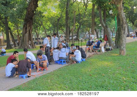 HANOI VIETNAM - NOVEMBER 22, 2016: Unidentified people play traditional board game in Lenin Statue Park.
