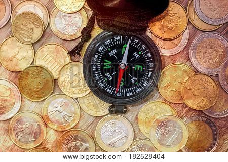Financial Concept  - Compass With Gold Coin. Close Up.