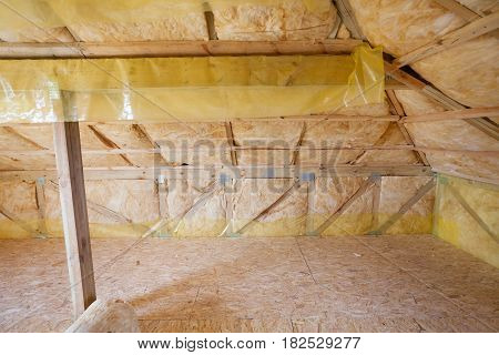 Attic with environmentally friendly and energy efficient thermal insulation rockwool.