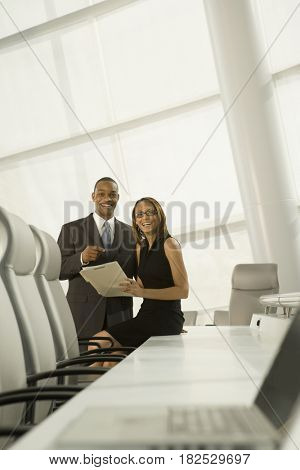 African business people posing in conference room