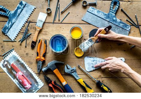 instruments set for decorating and building renovation on wooden work background top view
