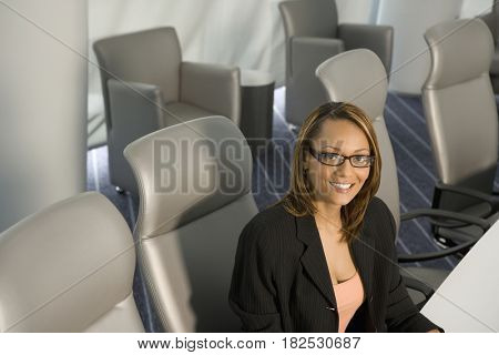 African businesswoman sitting in conference room