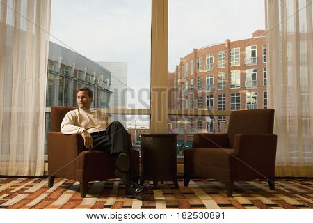 Businessman sitting in hotel waiting area
