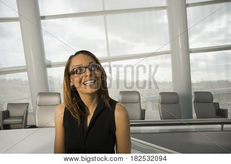 African businesswoman smiling in conference room