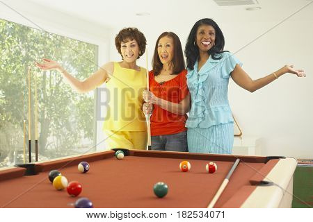 Multi-ethnic group of friends playing pool